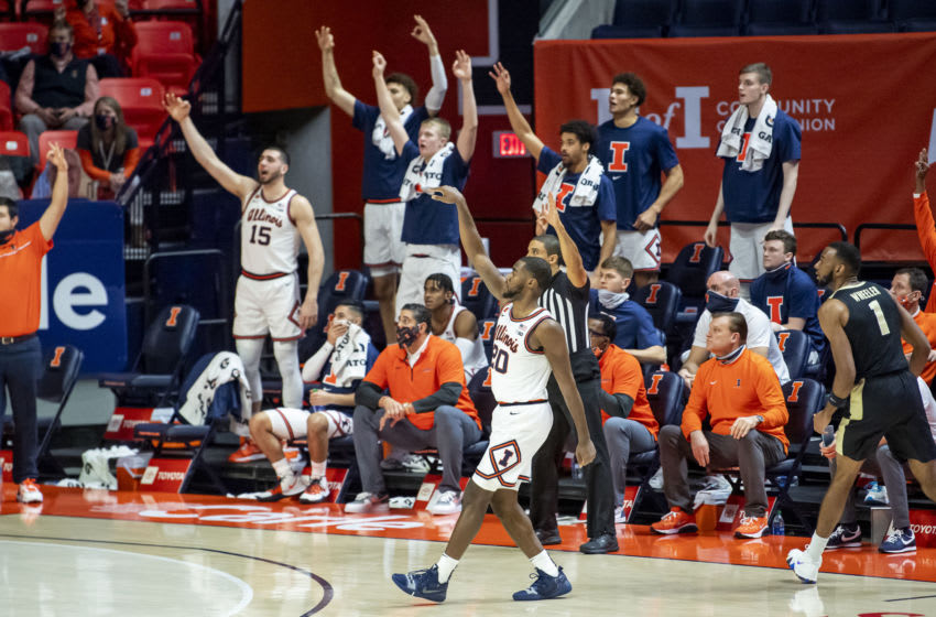 Jan 2, 2021; Champaign, Illinois, USA; Illinois Fighting Illini guard Da'Monte Williams (20) reacts after making a three point basket against the Purdue Boilermakers during the second half at the State Farm Center. Mandatory Credit: Patrick Gorski-USA TODAY Sports