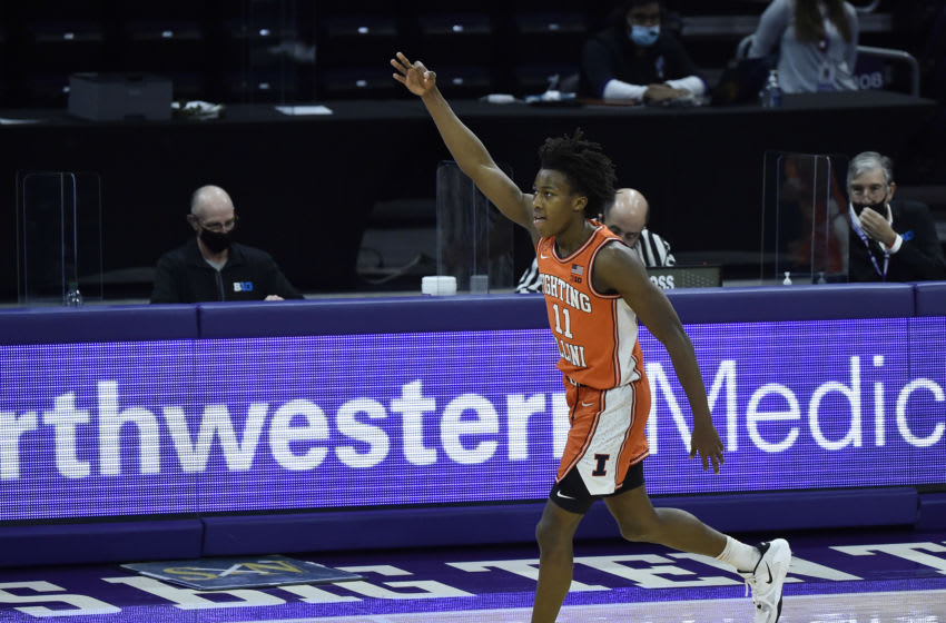 Jan 7, 2021; Evanston, Illinois, USA; Illinois Fighting Illini guard Ayo Dosunmu (11) reacts after his three point basket in the second half against the Northwestern Wildcats at Welsh-Ryan Arena. Mandatory Credit: Quinn Harris-USA TODAY Sports