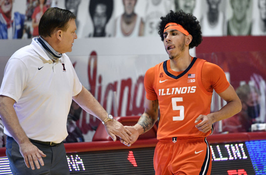 Feb 2, 2021; Bloomington, Indiana, USA; Illinois Fighting Illini guard Andre Curbelo (5) high fives Illinois Fighting Illini head coach Brad Underwood (L) during the second half against the Indiana Hoosiers at Simon Skjodt Assembly Hall. Mandatory Credit: Marc Lebryk-USA TODAY Sports