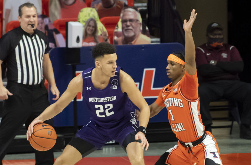 Feb 16, 2021; Champaign, Illinois, USA; Northwestern Wildcats forward Pete Nance (22) controls the ball against Illinois Fighting Illini guard Trent Frazier (1) during the first half at the State Farm Center. Mandatory Credit: Patrick Gorski-USA TODAY Sports