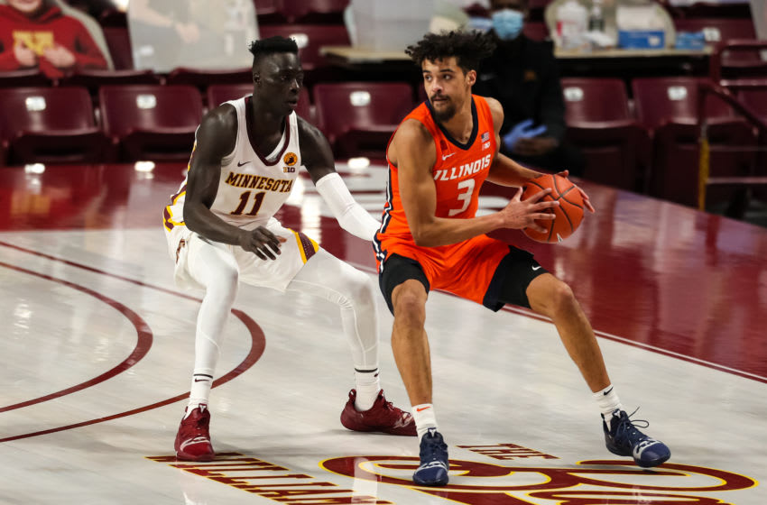 Feb 20, 2021; Minneapolis, Minnesota, USA; Illinois Fighting Illini guard Jacob Grandison (3) in action while Minnesota Golden Gophers guard Both Gach (11) defends in the first half at Williams Arena. Mandatory Credit: David Berding-USA TODAY Sports