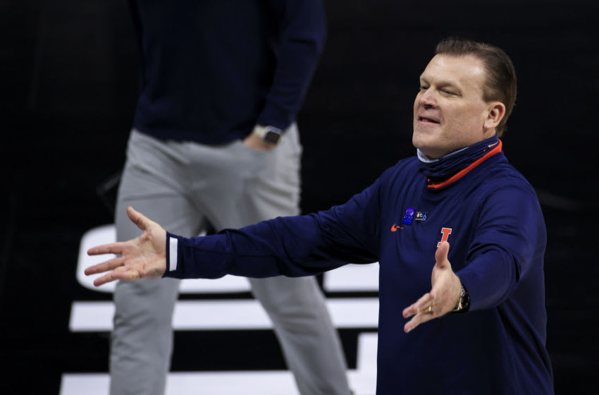 Mar 13, 2021; Indianapolis, Indiana, USA; Illinois Fighting Illini head coach Brad Underwood reacts to the crowd after his team defeats the Iowa Hawkeyes at Lucas Oil Stadium. Mandatory Credit: Aaron Doster-USA TODAY Sports