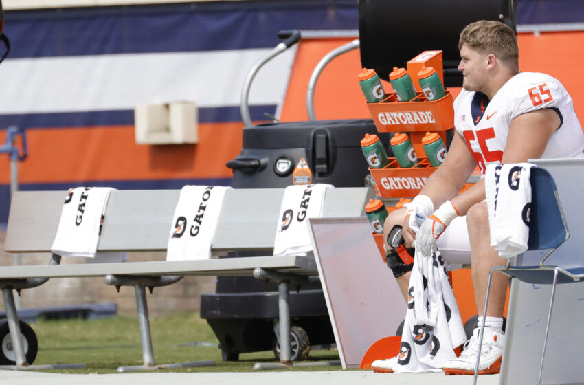 Sep 11, 2021; Charlottesville, Virginia, USA; Illinois Fighting Illini offensive lineman Doug Kramer (65) sits on the bench against the Virginia Cavaliers in the fourth quarter at Scott Stadium. Mandatory Credit: Geoff Burke-USA TODAY Sports