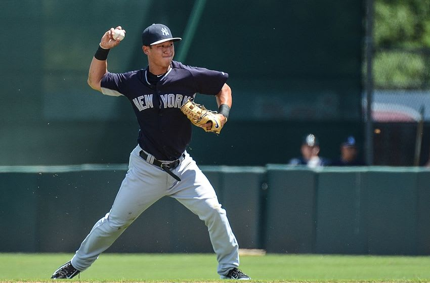 Mar 31, 2015; Fort Myers, FL, USA; New York Yankees infielder Rob Refsnyder (98) prepares to throw to first base in the first inning of the spring training game against the Minnesota Twins at CenturyLink Sports Complex. Mandatory Credit: Jonathan Dyer-USA TODAY Sports