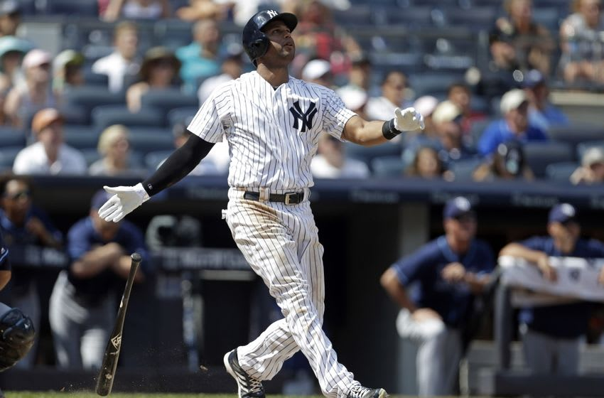 Aug 13, 2016; Bronx, NY, USA; New York Yankees right fielder Aaron Hicks (31) hits a three-run home run during the fifth inning against the Tampa Bay Rays at Yankee Stadium. Mandatory Credit: Adam Hunger-USA TODAY Sports
