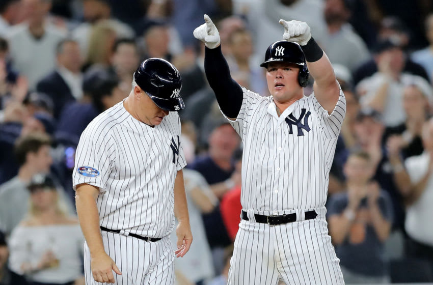 NEW YORK, NEW YORK - OCTOBER 03: Luke Voit #45 of the New York Yankees celebrates after hitting two RBI triple against the Oakland Athletics during the sixth inning in the American League Wild Card Game at Yankee Stadium on October 03, 2018 in the Bronx borough of New York City. (Photo by Elsa/Getty Images)
