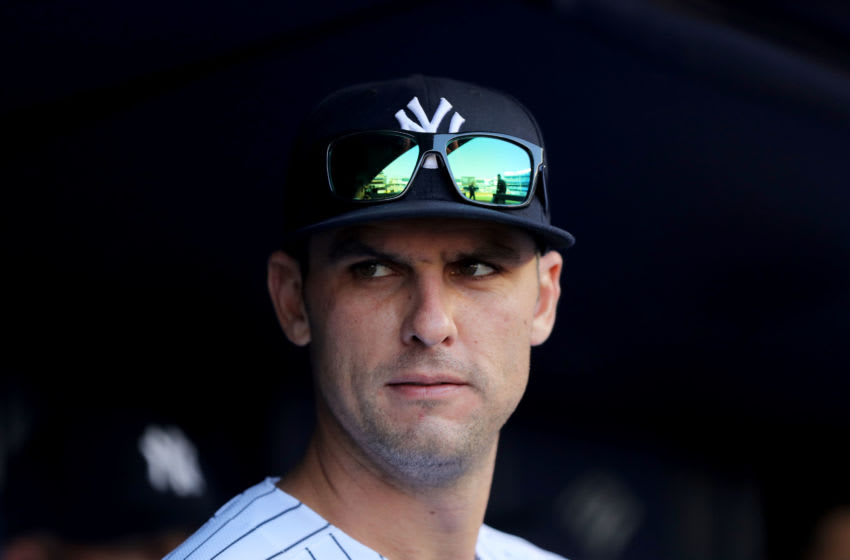 Greg Bird #33 of the New York Yankees stands in the dugout before the game against the Detroit Tigers at Yankee Stadium on April 03, 2019 in the Bronx borough of New York City. (Photo by Elsa/Getty Images)