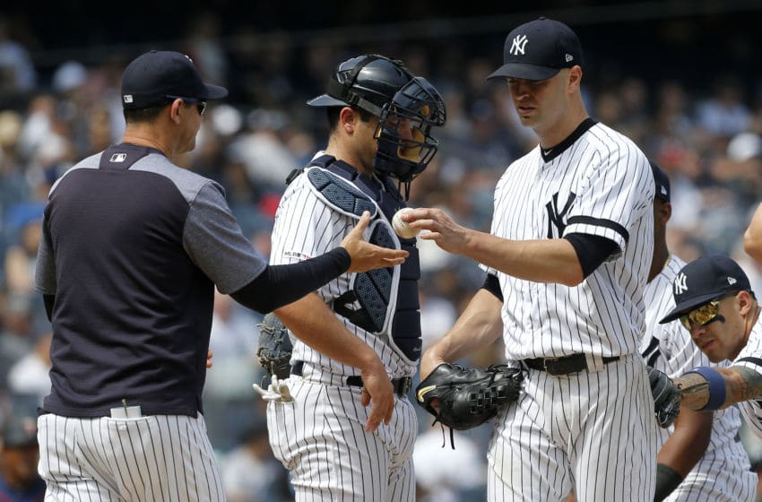 NEW YORK, NEW YORK - MAY 04: J.A. Happ #34 of the New York Yankees hands the ball to manager Aaron Boone as he leaves a game in the seventh inning against the Minnesota Twins at Yankee Stadium on May 04, 2019 in the Bronx borough of New York City. (Photo by Jim McIsaac/Getty Images)