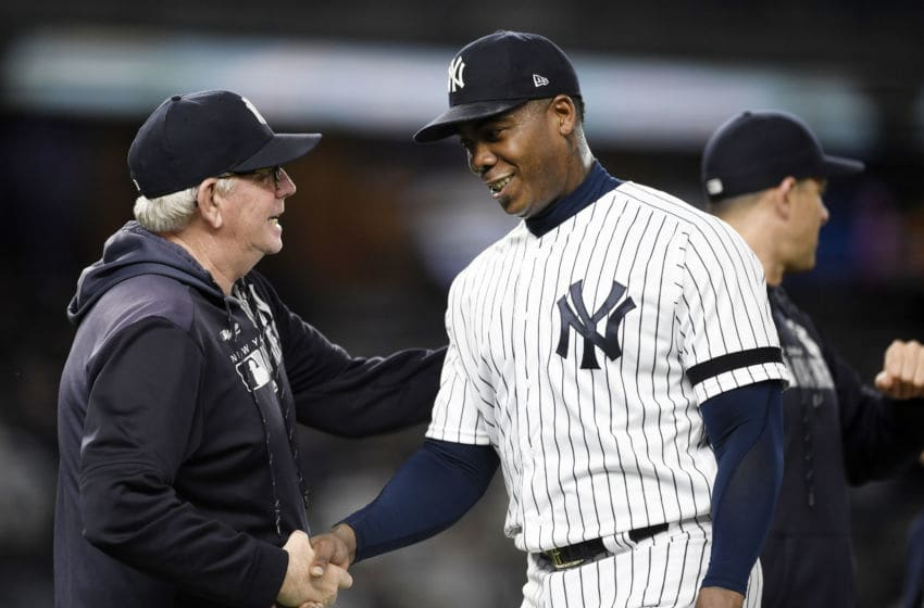 NEW YORK, NEW YORK - MAY 15: Pitching coach Larry Rothschild #58 of the New York Yankees congratulates closing pitcher Aroldis Chapman #54 after the Yankees win 3-1 during game two of a double header against the Baltimore Orioles at Yankee Stadium on May 15, 2019 in the Bronx borough of New York City. (Photo by Sarah Stier/Getty Images)