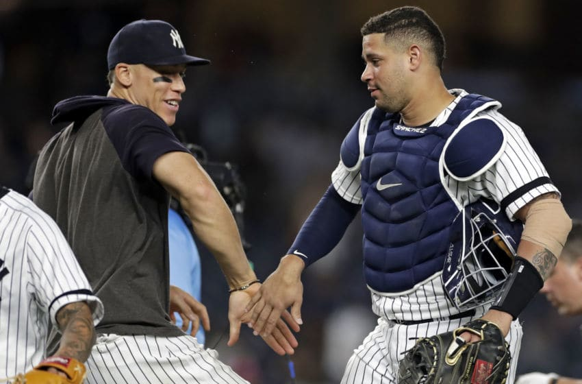 NEW YORK, NY - SEPTEMBER 3: Gary Sanchez #24 of the New York Yankees and Aaron Judge #99 of the New York Yankees celebrate after defeating the Texas Rangers at Yankee Stadium on September 3, 2019 in the Bronx borough of New York City. The Yankees won 10-1. (Photo by Adam Hunger/Getty Images)