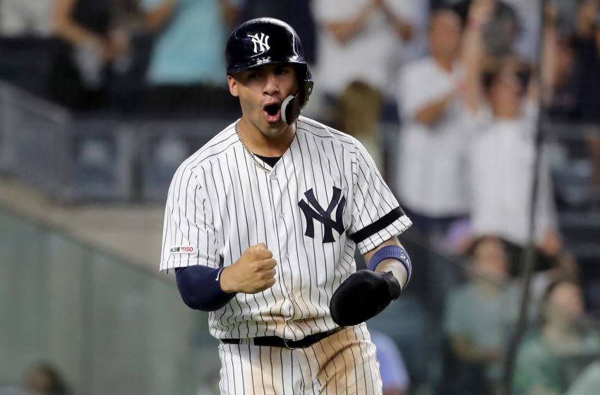 NEW YORK, NEW YORK - AUGUST 03: Gleyber Torres #25 of the New York Yankees celebrates after he scored in the seventh inning against the Boston Red Sox during game two of a double header at Yankee Stadium on August 03, 2019 in New York City. (Photo by Elsa/Getty Images)