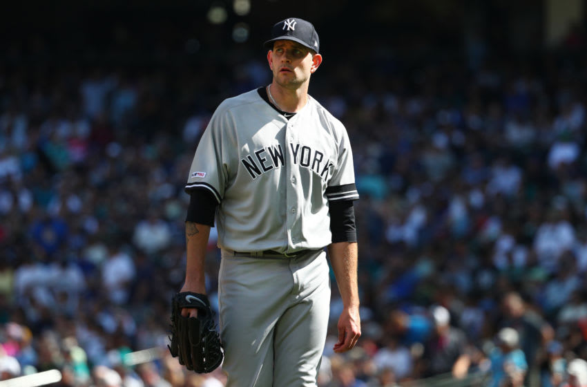 SEATTLE, WASHINGTON - AUGUST 28: James Paxton #65 of the New York Yankees reacts while walking back to the dugout after giving up a two run home run against Kyle Seager #15 of the Seattle Mariners in the fourth inning during their game at T-Mobile Park on August 28, 2019 in Seattle, Washington. (Photo by Abbie Parr/Getty Images)