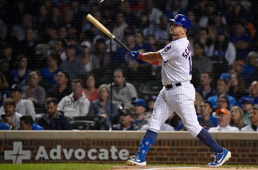 CHICAGO, ILLINOIS - SEPTEMBER 16: Kyle Schwarber #12 of the Chicago Cubs hits a three run home run in the first inning against the Cincinnati Reds at Wrigley Field on September 16, 2019 in Chicago, Illinois. (Photo by Quinn Harris/Getty Images)