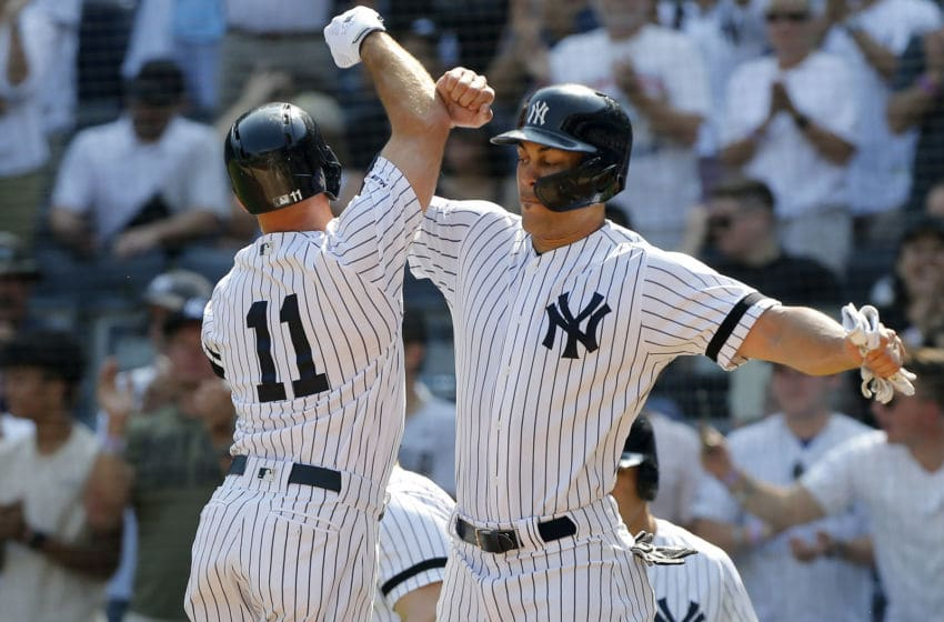 NEW YORK, NEW YORK - SEPTEMBER 22: Brett Gardner #11 of the New York Yankees celebrates his first inning three run home run against the Toronto Blue Jays with teammate Giancarlo Stanton #27 at Yankee Stadium on September 22, 2019 in New York City. (Photo by Jim McIsaac/Getty Images)