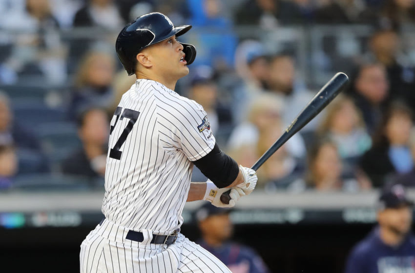 NEW YORK, NEW YORK - OCTOBER 05: Giancarlo Stanton #27 of the New York Yankees hits a sacrifice fly to score Aaron Judge #99 in the third inning of game two of the American League Division Series at Yankee Stadium on October 05, 2019 in New York City. (Photo by Elsa/Getty Images)