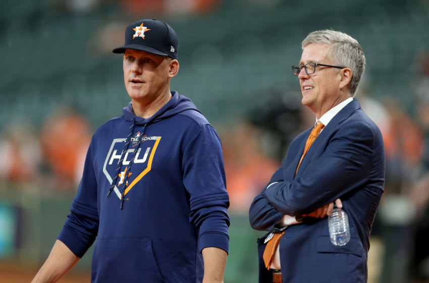 HOUSTON, TEXAS - OCTOBER 05: Manager AJ Hinch #14 talks with Jeff Luhnow, General Manager of the Houston Astros, prior to game two of the American League Division Series against the Tampa Bay Rays at Minute Maid Park on October 05, 2019 in Houston, Texas. (Photo by Bob Levey/Getty Images)