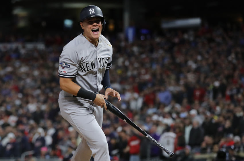 MINNEAPOLIS, MINNESOTA - OCTOBER 07: Gio Urshela #29 of the New York Yankees celebrates after scoring against the Minnesota Twins on a single by Brett Gardner #11 in game three of the American League Division Series at Target Field on October 07, 2019 in Minneapolis, Minnesota. (Photo by Elsa/Getty Images)