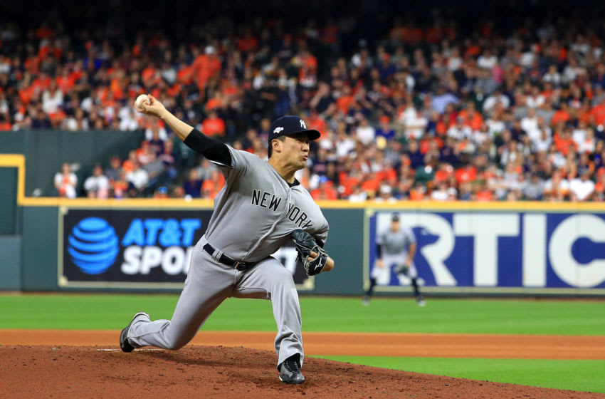 HOUSTON, TEXAS - OCTOBER 12: Masahiro Tanaka #19 of the New York Yankees delivers the pitch against the Houston Astros during the fourth inning in game one of the American League Championship Series at Minute Maid Park on October 12, 2019 in Houston, Texas. (Photo by Mike Ehrmann/Getty Images)