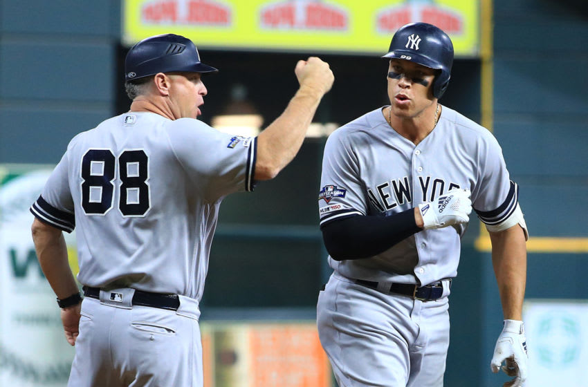 HOUSTON, TEXAS - OCTOBER 13: Aaron Judge #99 of the New York Yankees celebrates with third base coach Phil Nevin #88 after hitting a two-run home run during the fourth inning against the Houston Astros in game two of the American League Championship Series at Minute Maid Park on October 13, 2019 in Houston, Texas. (Photo by Mike Ehrmann/Getty Images)
