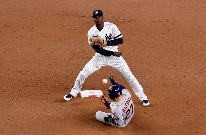 NEW YORK, NEW YORK - OCTOBER 18: Didi Gregorius #18 of the New York Yankees tags out Jose Altuve #27 of the Houston Astros during the seventh inning in game five of the American League Championship Series at Yankee Stadium on October 18, 2019 in New York City. (Photo by Emilee Chinn/Getty Images)
