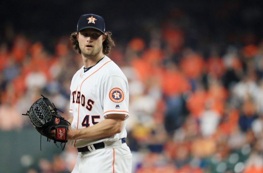 HOUSTON, TEXAS - OCTOBER 22: Gerrit Cole #45 of the Houston Astros reacts against the Washington Nationals during the third inning in Game One of the 2019 World Series at Minute Maid Park on October 22, 2019 in Houston, Texas. (Photo by Mike Ehrmann/Getty Images)