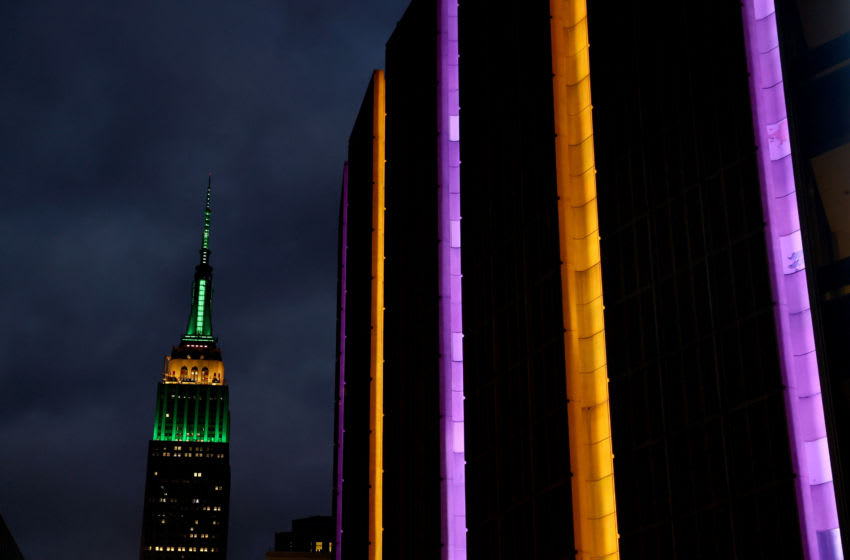 NEW YORK, NEW YORK - JANUARY 26: Madison Square Garden is lit up in Los Angeles Lakers colors in honor of former Laker great Kobe Bryant prior to the game between the New York Knicks and the Brooklyn Nets tonight at Madison Square Garden on January 26, 2020 in New York City. Five people, including Bryant and his 13-year-old daughter Gianna, were killed in a helicopter crash this morning in Calabasas, California. NOTE TO USER: User expressly acknowledges and agrees that, by downloading and or using this photograph, User is consenting to the terms and conditions of the Getty Images License Agreement. (Photo by Elsa/Getty Images)