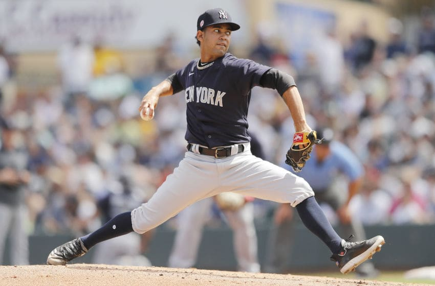 JUPITER, FLORIDA - MARCH 11: Deivi Garcia #83 of the New York Yankees delivers a pitch against the Miami Marlins during a Grapefruit League spring training at Roger Dean Stadium on March 11, 2020 in Jupiter, Florida. (Photo by Michael Reaves/Getty Images)