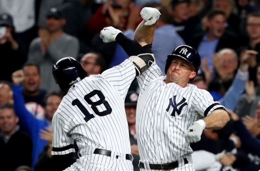 NEW YORK, NY - OCTOBER 03: Didi Gregorius #18 of the New York Yankees celebrates with Brett Gardner #11 after hitting a three run home run against Ervin Santana #54 of the Minnesota Twins during the first inning in the American League Wild Card Game at Yankee Stadium on October 3, 2017 in the Bronx borough of New York City. (Photo by Al Bello/Getty Images)