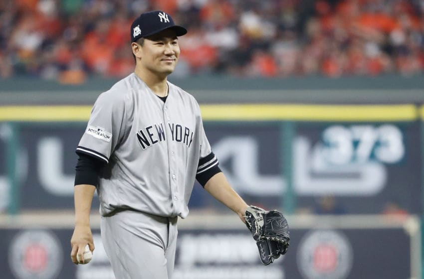 HOUSTON, TX - OCTOBER 13: Masahiro Tanaka #19 of the New York Yankees reacts against the Houston Astros during game one of the American League Championship Series at Minute Maid Park on October 13, 2017 in Houston, Texas. (Photo by Elsa/Getty Images)