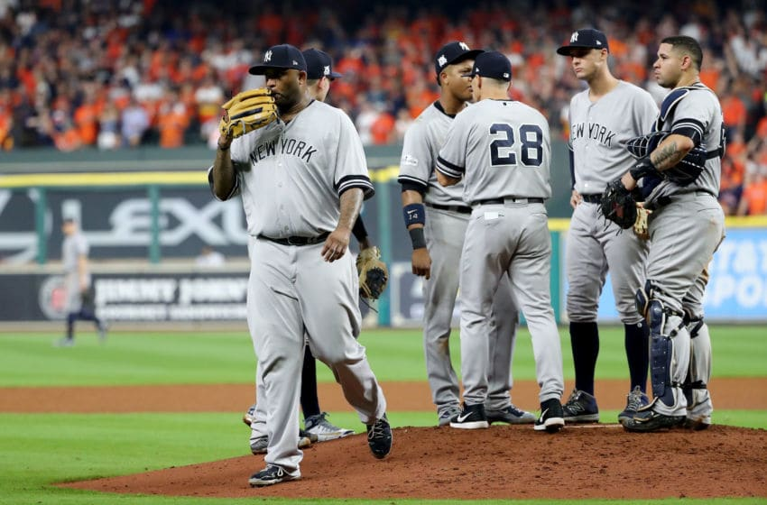 HOUSTON, TX - OCTOBER 21: CC Sabathia #52 of the New York Yankees walks back to the dugout after being relieved in the fourth inning against the Houston Astros in Game Seven of the American League Championship Series at Minute Maid Park on October 21, 2017 in Houston, Texas. (Photo by Elsa/Getty Images)