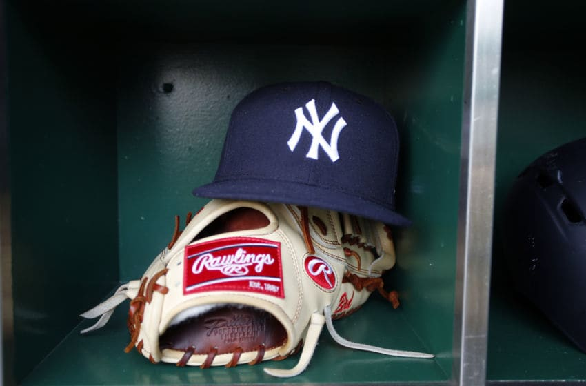 PITTSBURGH, PA - APRIL 21: A New York Yankees hat and Rawlings baseball glove is seen during the game against the Pittsburgh Pirates at PNC Park on April 21, 2017 in Pittsburgh, Pennsylvania. (Photo by Justin K. Aller/Getty Images) *** Local Caption ***