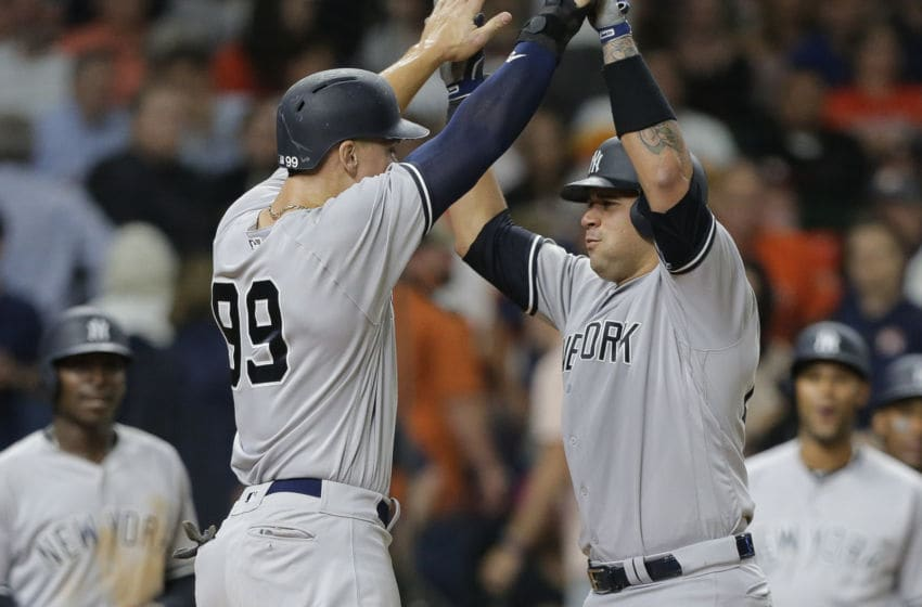 HOUSTON, TX - MAY 01: Aaron Judge #99 of the New York Yankees congratulates Gary Sanchez #24 after Sanchez hit a three-run home run in the ninth inning at Minute Maid Park on May 1, 2018 in Houston, Texas. (Photo by Bob Levey/Getty Images)