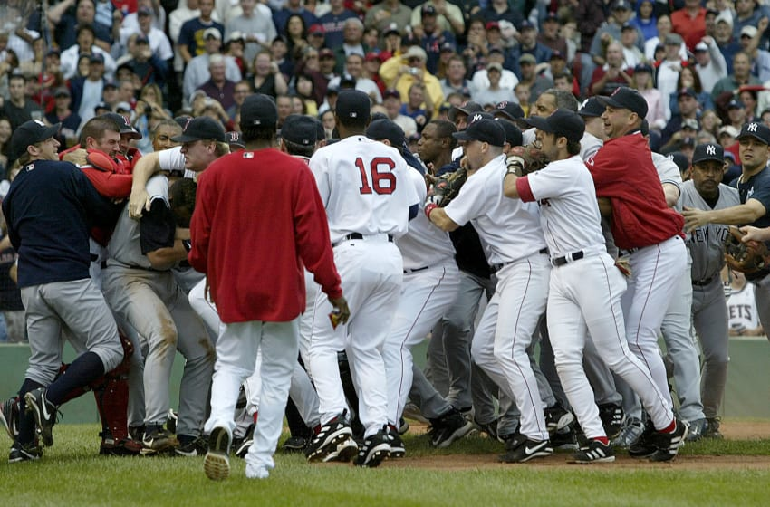 Boston Red Sox and the New Yankees brawl in the third inning after Yankees batter Alex Rodriguez was hit by a pitch by Red Sox's Bronson Arroyo at Fenway Park in Boston. The Red Sox won, 11-10, with a 9th-inning game winning home run by Bill Mueller (Photo by J Rogash/Getty Images)