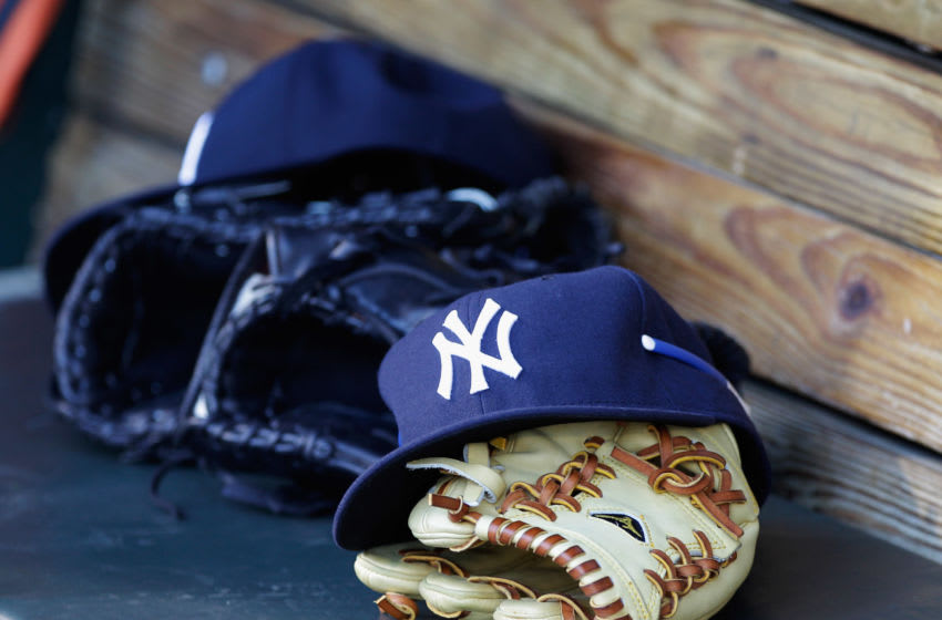 Yankees gear sitting in the dugout. (Photo by Rob Carr/Getty Images)