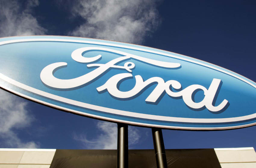 FLAT ROCK, MI - SEPTEMBER 10: A Ford logo is shown at an event that celebrates the opening of the new U.S. production line where the 2013 Ford Fusion midsize sedan will be made at the Flat Rock Assembly Plant September 10, 2012 in Flat Rock, Michigan. Supporting its Fusion production growth plan, Ford is adding 1,200 jobs, a second production shift, and investing $555 million, and taking full management control of the former AutoAlliance International Plant. (Photo by Bill Pugliano/Getty Images)