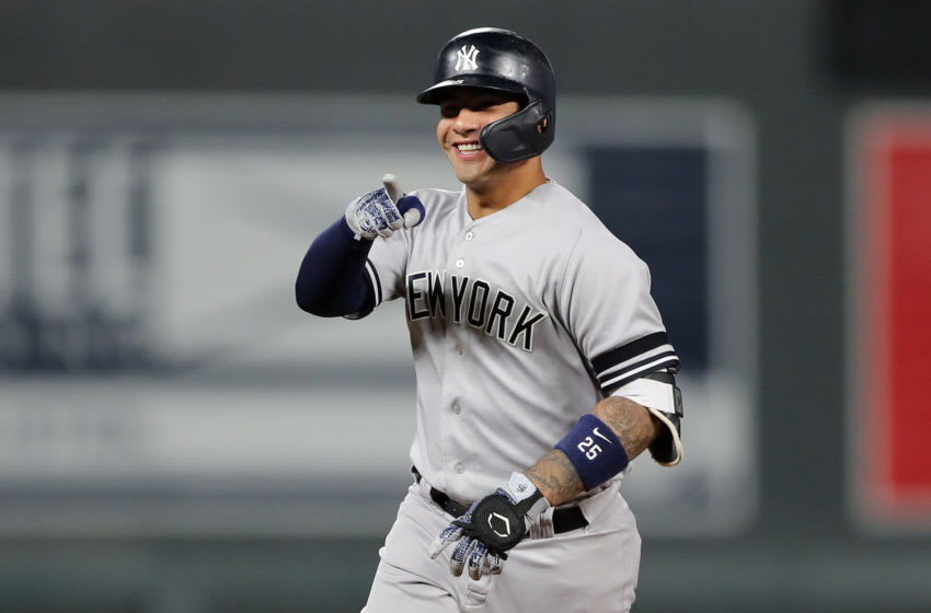 MINNEAPOLIS, MINNESOTA - OCTOBER 07: Gleyber Torres #25 of the New York Yankees celebrates after his solo home run off Jake Odorizzi #12 of the Minnesota Twins in the second inning in game three of the American League Division Series at Target Field on October 07, 2019 in Minneapolis, Minnesota. (Photo by Elsa/Getty Images)