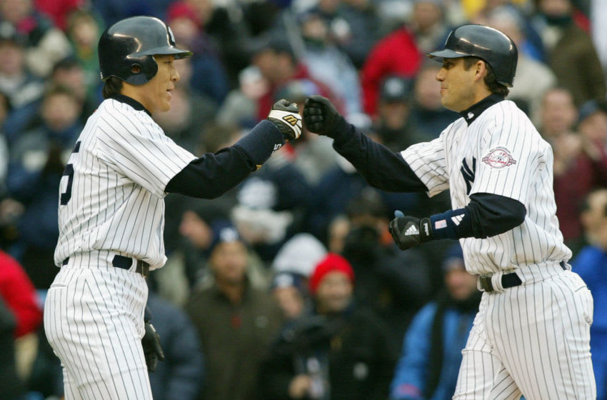 Hideki Matsui (L) of the New York Yankees congratulates teammate Robin Ventura after Ventura hit a two-run home run against the Minnesota Twins 08 April, 2003, at Yankees Stadium in the Bronx. AFP PHOTO/Don EMMERT (Photo by Don EMMERT / AFP) (Photo by DON EMMERT/AFP via Getty Images)