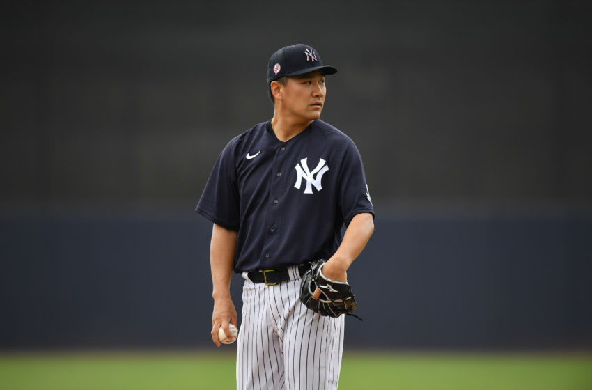 TAMPA, FLORIDA - FEBRUARY 26: Masahiro Tanaka #19 of the New York Yankees gets ready to pitch during the spring training game against the Washington Nationals at Steinbrenner Field on February 26, 2020 in Tampa, Florida. (Photo by Mark Brown/Getty Images)
