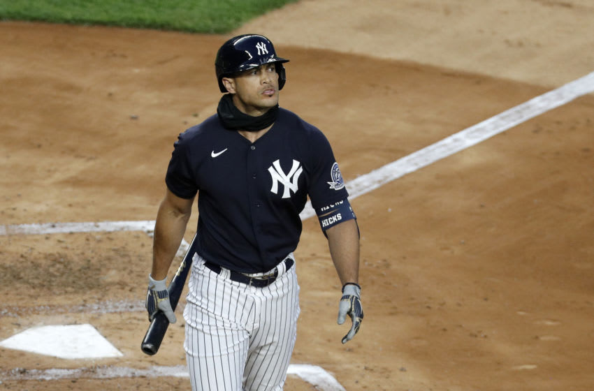 NEW YORK, NEW YORK - JULY 06: (NEW YORK DAILIES OUT) Giancarlo Stanton #27 of the New York Yankees looks on during summer workouts at Yankee Stadium on July 06, 2020 in New York City. (Photo by Jim McIsaac/Getty Images)