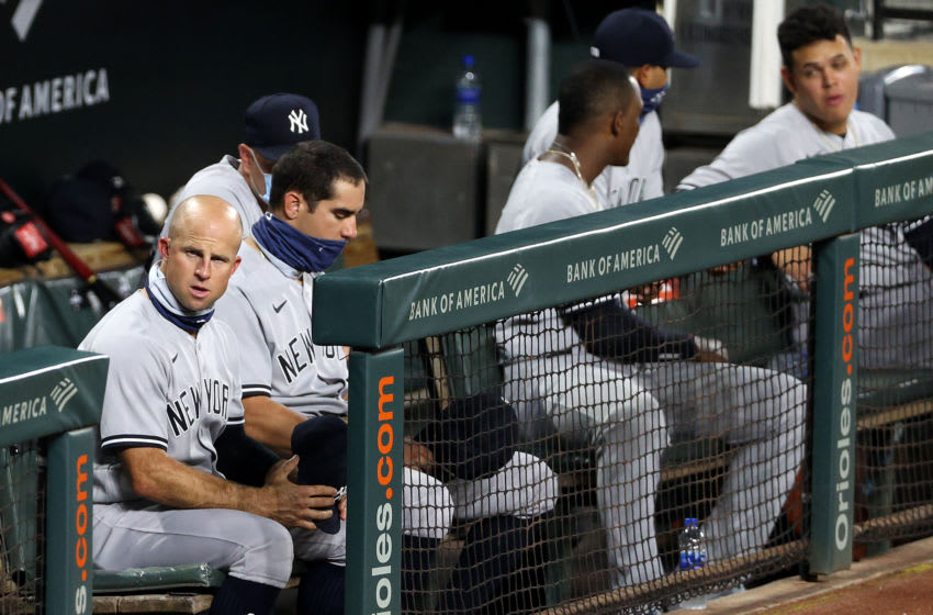 BALTIMORE, MARYLAND - JULY 30: Brett Gardner #11 of the New York Yankees sits in the dugout against the Baltimore Orioles at Oriole Park at Camden Yards on July 30, 2020 in Baltimore, Maryland. (Photo by Rob Carr/Getty Images)