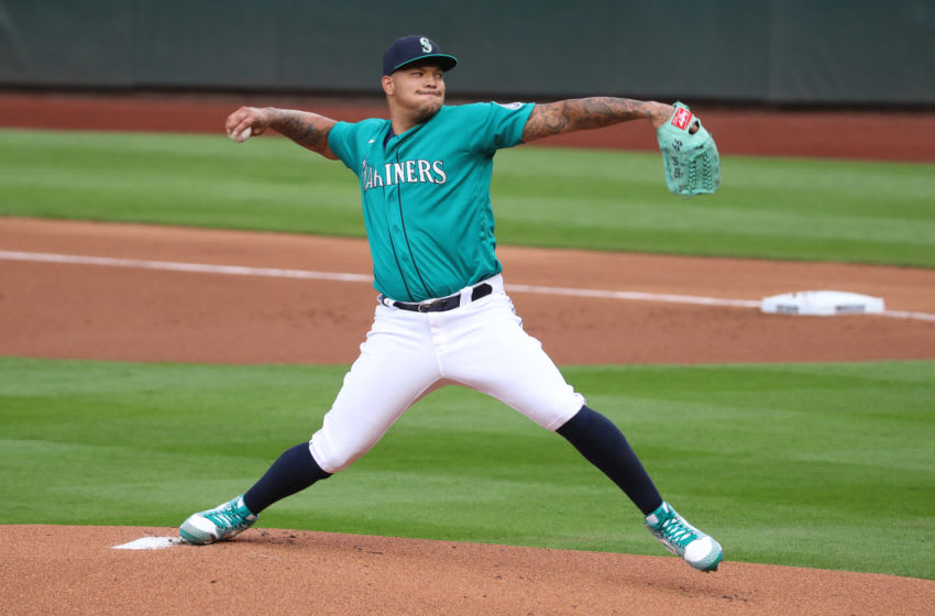 SEATTLE, WASHINGTON - JULY 31: Taijuan Walker #99 of the Seattle Mariners pitches in the first inning against the Oakland Athletics during their Opening Day game at T-Mobile Park on July 31, 2020 in Seattle, Washington. (Photo by Abbie Parr/Getty Images)