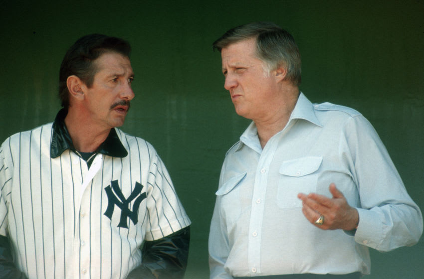 Manager Billy Martin #1 of the New York Yankees talks with owner George Steinbrenner (Photo by Focus on Sport/Getty Images)