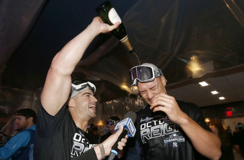 Tyler Wade #14 and Aaron Judge #99 of the New York Yankees celebrate (Photo by Elsa/Getty Images)