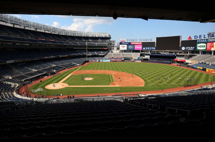 Clarke Schmidt and the New York Yankees work out in an empty stadium (Photo by Elsa/Getty Images)