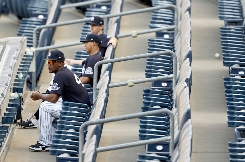 Miguel Andujar #41 of the New York Yankees sits in the stands in the first inning against the Philadelphia Phillies during a Summer Camp game at Yankee Stadium on July 20, 2020 in the Bronx borough of New York City. (Photo by Elsa/Getty Images)