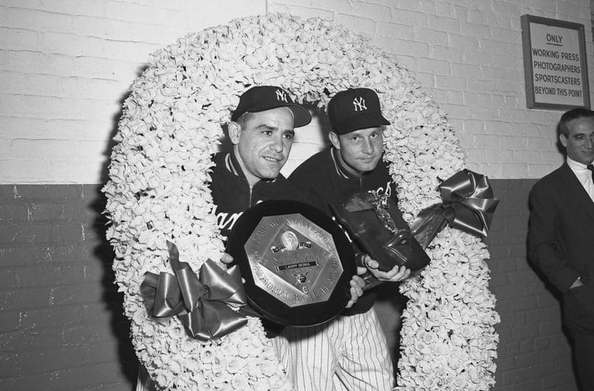 Catcher Yogi Berra and pitcher Bob Grim, of the New York Yankees (Photo by: Olen Collection/Diamond Images/Getty Images)