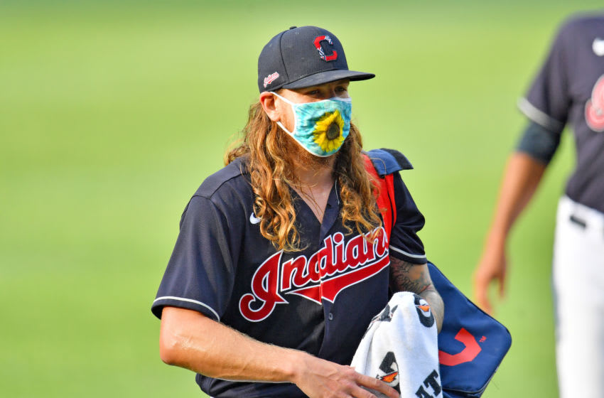 Starting pitcher Mike Clevinger #52 of the Cleveland Indians waves to a teammate prior to the gam against the Pittsburgh Pirates at Progressive Field on July 20, 2020 in Cleveland, Ohio. (Photo by Jason Miller/Getty Images)