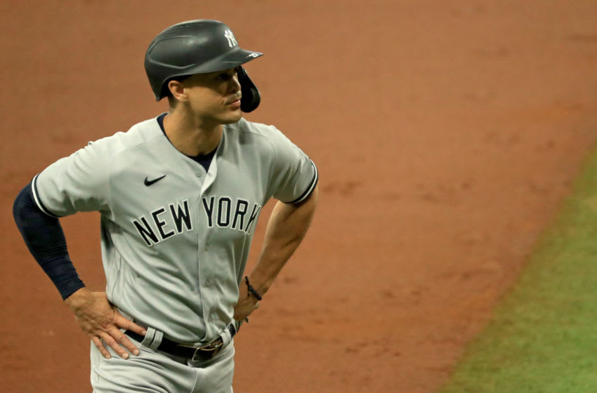 Giancarlo Stanton #27 of the New York Yankees looks on during Game 1 of a doubleheader against the Tampa Bay Rays at Tropicana Field on August 08, 2020 in St Petersburg, Florida. (Photo by Mike Ehrmann/Getty Images)