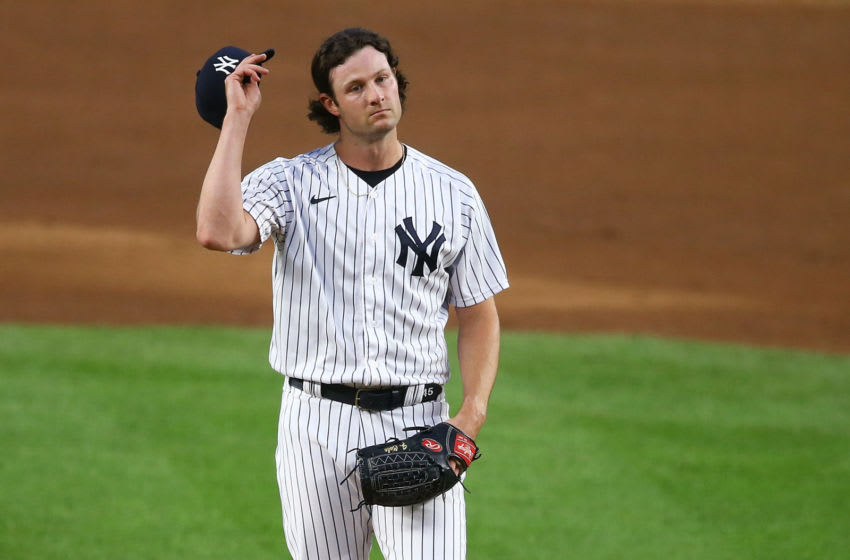 Gerrit Cole #45 of the New York Yankees reacts in the first inning against the Tampa Bay Rays at Yankee Stadium on August 31, 2020 in New York City. (Photo by Mike Stobe/Getty Images)