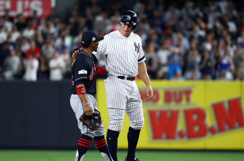 Aaron Judge #99 of the New York Yankees and Francisco Lindor #12 of the Cleveland Indians talk at second base during the sixth inning in game three of the American League Division Series at Yankee Stadium on October 8, 2017 in New York City. (Photo by Al Bello/Getty Images)